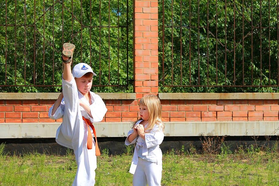 Boy showing girl karate